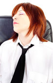Tired woman with tie sleeping in chair — Stock Photo