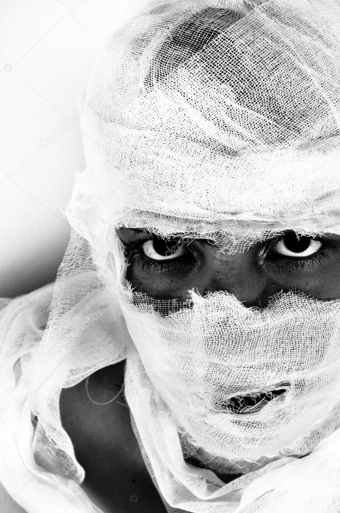 Scary portrait of a girl wrapped in bandage — Stock Photo #5971643