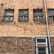 Angle shot of an abandoned industrial building with brick wall — Stock Photo #6299515