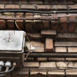 Old brick wall with electrical boxes - Lizenzfreies Foto