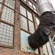 Fragment of old industrial building with heat pipe - 图库照片