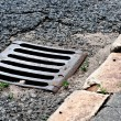 Sewer drain on road — Foto Stock