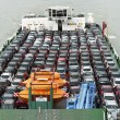 Boat carries a lot of cars to market — Stock Photo