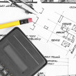 Calculator and pencil on construction plans — Stock Photo #6299599