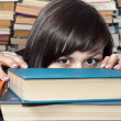 Stock Photo: Young beautiful student girl behind books