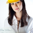 Beautiful business woman with construction plans — Stock Photo #6299666