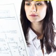 Engineer woman in yellow helmet with plans — Stock Photo #6299667