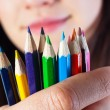 Student girl with colored pencils — Stock Photo