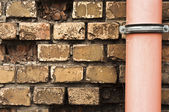 Drain pipe against brick wall — Stock Photo