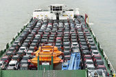 Boat carries a lot of cars to market — Stockfoto