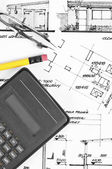 Calculator and pencil on construction plans — Stock Photo