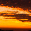 Stok fotoğraf: Orange sunset with clouds