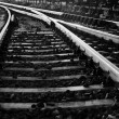 Black and white photo of some old rails — Stock Photo