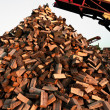 Firewood piled up with great machines - Photo