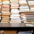 Books piled up against black desk - 