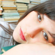 Beautiful young student girl almost asleep on her books — Stock Photo