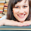 Cheerful young university student and her books — Stock Photo