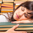 Overworked university student sleeping on her books — Stockfoto