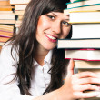 School girl holding her books and smiling — Stockfoto