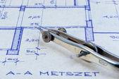 Closeup of a bow on blueprints — Stock Photo