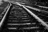 Black and white photo of some old rails — Fotografia Stock