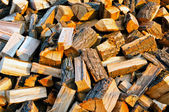 Texture of firewood piled up with evening light — Stock Photo
