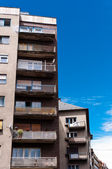 Apartment building against blue sky — Stok fotoğraf