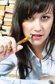 Serious student girl with her pen — Stock Photo