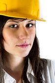 Engineer woman in yellow helmet against white isolated backgroun — Stock Photo