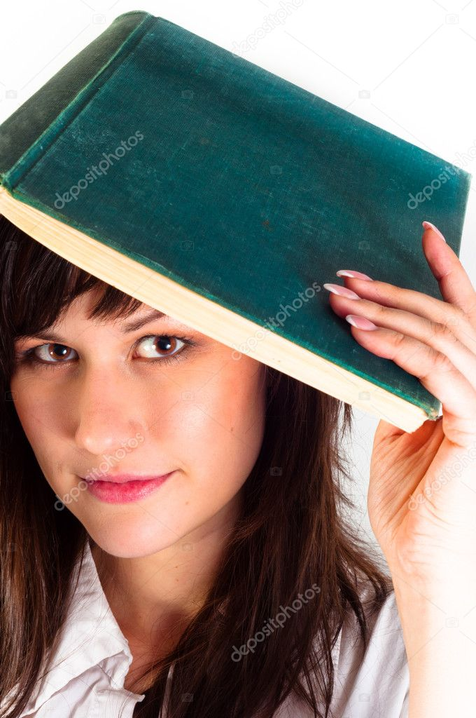 Young girl and her book against white background  Stock Photo #6733781