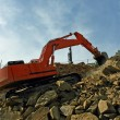 Excavator crushing rocks — Stock Photo #6163830
