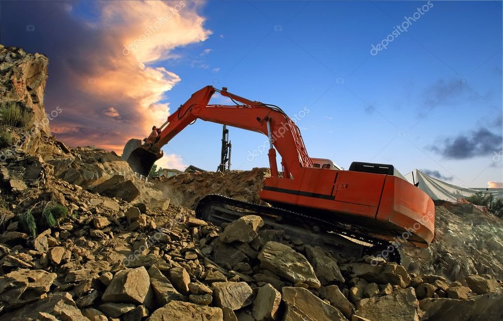 Excavator digging mountain by crushing rocks with its shovel — Stock Photo #6185124