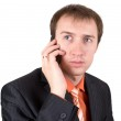 The businessman speaks by a mobile phone — Stock Photo