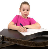 Het meisje doet huiswerk — Stockfoto