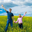 The father with a daughter on a meadow — Stock Photo