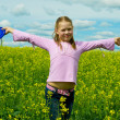 Girl with frisbee on a meadow — Stock Photo #5972585