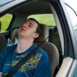 The man sleeps in the car - Stockfoto