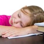 The girl has fallen asleep over textbooks — Stock Photo