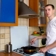 Adult man cooking at the kitchen — Stock Photo #6056401