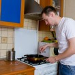 Adult man cooking at the kitchen alone — Stock Photo #6056405