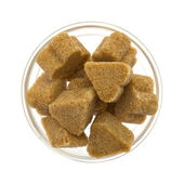 Brown sugar in a glass bowl — Stock Photo