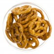 Salted pretzels in glass bowl isolated — Stockfoto