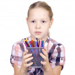 Girl with colored pencils on white background — Stock Photo #6234105