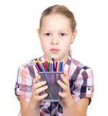 Girl with colored pencils on white background — Stok fotoğraf
