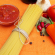 Royalty-Free Stock Photo: Raw spaghetti and few fresh tomatoes, pepper, garlic, chilly, ke