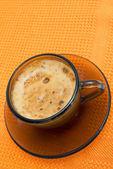 Cappuccino on napkin on white background — Stock Photo