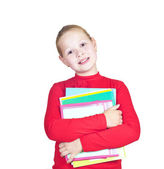 Child with a stack of notebooks — Stock Photo