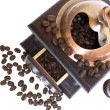 Stock Photo: Coffee grinder with coffee beans