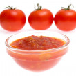 Ketchup and tomato on white — Stock Photo