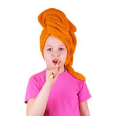 Girl brushing her teeth on a white background — Stock Photo